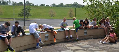 Students Sketch on Art Patio