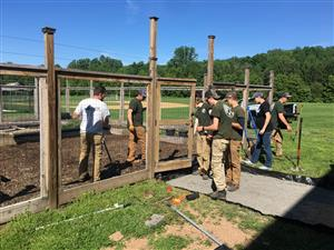 MBIT students work on the Holicong garden
