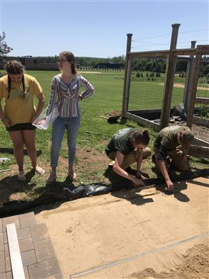 holicong students look on while MBIT student complete the walkway