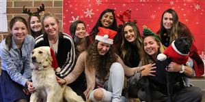 students pose with ROXY therapy dogs