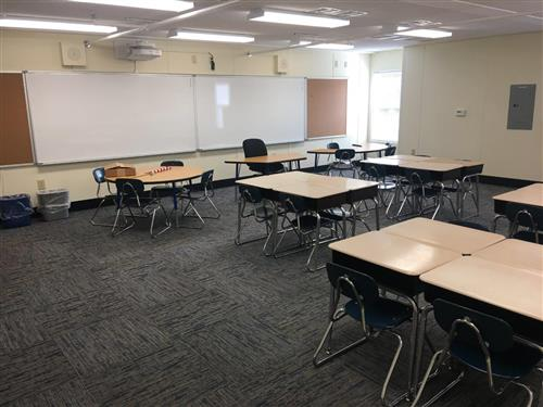Finished butler modular classroom with desks and white boards
