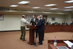 Teacher recieving board certification certificate