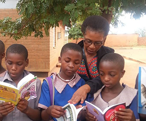 Malawi students read donated books from Groveland.